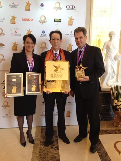 Ms. Loraine Berry, Head of Development, Mr. Larry Stradmoor, General Manager of Lanson Place Central Park Serviced Residences and Mr. Marc Hediger, Chief Executive Officer of Lanson Place Hospitality Management proudly receive 3 awards at The China Hotel Starlight Awards in Shenzhen on 12 March 2014.