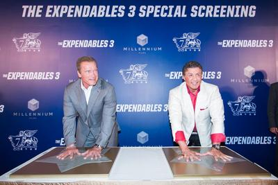 Sylvester Stallone and Arnold Schwarzenegger take part in a hand printing ceremony at The Venetian Macao Friday for Asia's only special screening of their latest blockbuster film, The Expendables 3.