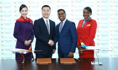 Manoj Papa, Chief Executive Officer of Air Seychelles, and Li Dianchun, Commercial Director of Hong Kong Airlines, sign a codeshare agreement between the two airlines