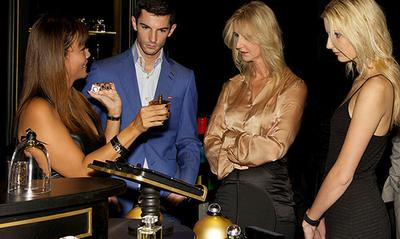 Sonia Irvine, Alexander Rossi and guest, being guided through Fragrance Du Bois' first concept boutique at the Fullerton Hotel, Singapore