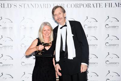 Tradition Well Served Director, Libby Halliday Palin (left), collects the Golden Dolphin Award at the Cannes Corporate and Media TV Awards on October 2, 2014.