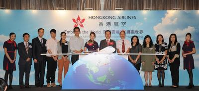 "Mr. Sun Jianfeng, Vice President of Hong Kong Airlines (Seventh from right), and Ms. Priscilla Wong , local artist (Seventh from left) host the kick-off ceremony of Hong Kong Airlines ""Embrace the World"" Student Sponsorship Programme."