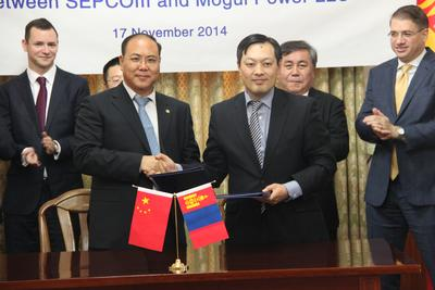 In the presence of Ambassador Sukhbaatar Ts., Mr. Zhang Hongsong, Vice President of SepcoIII (left) and Mr. Erdembileg J., CEO of Mogul Power LLC (right) celebrate the signing of the agreement.
