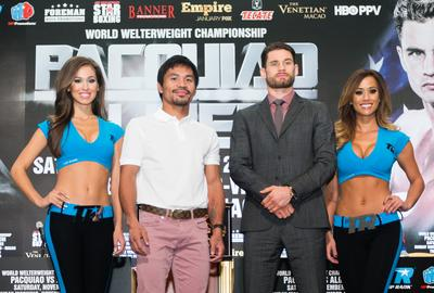 """The two superstar boxers – Fighter of the Decade Congressman Manny """"Pacman"""" Pacquiao (second from left) and undefeated World Boxing Organization (WBO) junior welterweight champion Chris Algieri (second from right) of Sunday's Clash in Cotai II attend a press conference Wednesday at The Venetian Macao. The multi-bout event kicks off at 8 a.m. Sunday at the Cotai Arena, with a limited number of tickets still available via Cotai Ticketing."""
