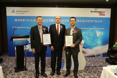 Mr. Uwe Halstenbach, Vice President & Managing Director, TUV Rheinland Greater China Electrical presents the world's first Smart Wearable Device and Paper Looking Display Certificates to Lenovo