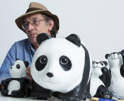 The Father of the 1600 Pandas! Paulo Grangeon, acclaimed French sculpture artist and designer with more than 30 years of experiences posing with his beloved Pandas, each with its very own unique expression.