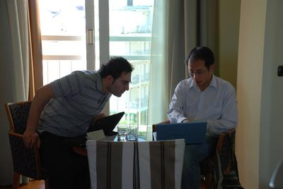 (L-R) Prof. Yasin Temel and Assoc. Prof. Lim Lee Wei found a specific brain target stimulation for depression. This picture was taken during the 2008 European Society for Stereotactic and Functional Neurosurgery meeting in Rimini, Italy. They were discussing brain targets for electrical stimulation in depression. (Photo: Dr. Sonny Tan)