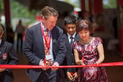 Dr. Amy Khor, Senior Minister of State for Ministry of Health and Ministry of Manpower, and Dr. Joseph Spence, Master of Dulwich College in London, preparing to cut the ribbon at Dulwich College Singapore's inaugural Founder's Day and official opening ceremony.