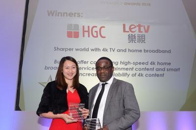 "Hong Kong's first bundling of 4K home broadband with entertainment content by Hutchison Global Communications Limited (HGC) and Letv has won a ""Consumer Service Innovation Award"" in the ninth Global Telecoms Business Innovation Awards. Sierra Ma (left), General Manager, International Business Development of Letv, and Oyovwe Okorodudu (right), Assistant Vice President, EMEA of Hutchison Global Communications Limited receive the honour on behalf of Letv and HGC."