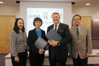 Mrs. Wilai Somdungjate-Ottevaere (2nd from left), Chief Marketing Officer of MQDC and Mr. Edward T. Reilly (3rd from left), President and CEO of AMA (American Management Association) signed agreement to provide self-development programmes offer for residents of MQDC's Whizdom-branded condominiums as well as Whizdom Society members at AMA's office New York, U.S.A.