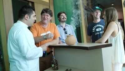 Ahmed Awad (extreme left), Asia Plantation Capital's resident expert on infusing Agarwood chips and powder, explaining the nuances of different fragrance infused wood chips to visitors from France.