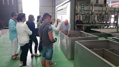 Steve Watts, CEO Asia Pacific (second from right), pointing out the features of Asia Plantation Capital's custom-designed agarwood distillery to visitors from Germany and Switzerland.