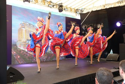 Dancers perform a French cancan at the topping out ceremony for The Parisian Macao's Eiffel Tower Thursday. Sands China's newest integrated resort and its half-scale replica Eiffel Tower are slated to open in the second half of 2016.