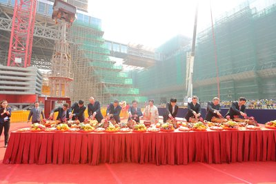 Officiating guests from Las Vegas Sands Corp., Sands China Ltd., Modern Heavy Industry Co Ltd., Hsin Chong Engineering (Macau) Limited, and Genyield Construction Co, Ltd. participate in a traditional Bai Sun ceremony during the topping out of The Parisian Macao's Eiffel Tower Thursday. Sands China's newest integrated resort and its half-scale replica Eiffel Tower are slated to open in the second half of 2016.