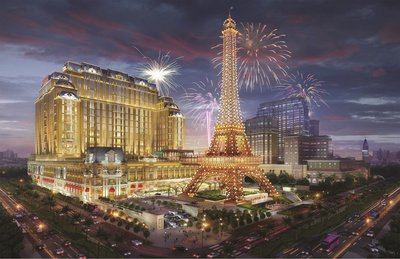 An artist's rendering depicts The Parisian Macao, slated to open in the second half of 2016. Sands China's newest integrated resort prominently features a half-scale replica Eiffel Tower, which topped out Thursday.