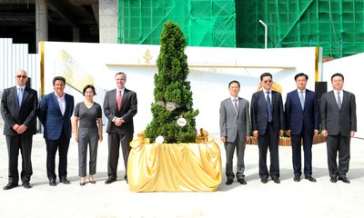 MGM China Holdings Limited celebrated the topping off of MGM COTAI today. Guests of Honor in attendance are (left to right) Mr. Grant Bowie, Mr. Bill Hornbuckle, Ms. Pansy Ho and Mr. Jim Murren from MGM, and Mr. Guan Qing, Mr. Hao Jianmin, Mr. Li Jianbo and Mr. Zhou Yong.