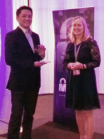 Receiving the award at the Mobile World Congress in Barcelona, Spain is Globe Vice President for Product Management Vince Yamat.