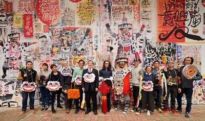 From left to right: Bosco Law (artist), Ho Sin Tung (artist), Esther Poon (artist), Lam Tung-pang (artist), William Lim (Architect of H Queen's), Patrick Sit (General Manager of Henderson Leasing Agency Company Ltd.), Kristine Li (Assistant General Manager of Henderson Leasing Agency Company Ltd.), Frog King (artist), Stanley Siu (artist), Peggy Chan (artist), Tony Ng (artist), Damon Tong (artist), South Ho (artist)