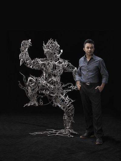 """Thai artist Banjerd Lekkong in his Bangkok studio with his iron sculpture """"Hanuman's Standing"""" ahead of his solo exhibition at Agora Gallery in New York from May 20 to June 9, 2016."""