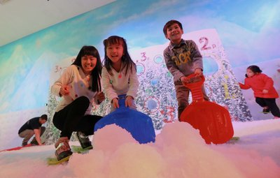 Laughter and fun fill Times Square's White Christmas as children build giant snowballs in the colourful Snow Chamber.
