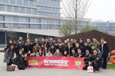 Top performing sellers across all Lazada markets pose in front of Alibaba's Hangzhou Campus