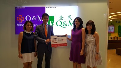 (Middle left) BookDoc Founder Dato Chevy Beh with Q & M Dental Group General Manager, Ms Foo Siew Jiuan