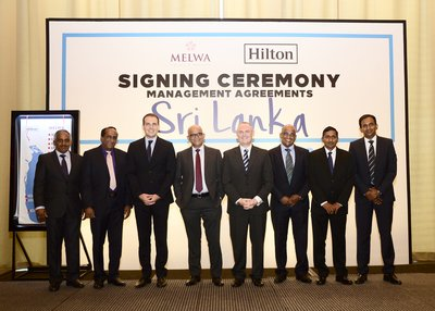 Signing Ceremony of Landmark Deal between Hilton and Melwa Hotels & Resorts to Open Six Hotels in Sri Lanka (From Left to Right: Mr. P P Barathakumar – Director Melwa Hotels & Resorts Pvt Ltd; Mr. P P Barathamanickam - Director Melwa Hotels & Resorts Pvt Ltd; Mr. Kieran Bestall – Director of Development Asia, Hilton; Prof. Ranjith Bandara – Director Business Development Melwa Hotels & Resorts Pvt. Ltd; Mr. William Costley – VP Operations SEA & India Hilton; Mr. P P Murganandhan - Director Melwa Hotels & Resorts Pvt Ltd; Mr. P P Anandharajah - Director Melwa Hotels & Resorts Pvt Ltd; Mr. P P Devaraj - Director Melwa Hotels & Resorts Pvt Ltd
