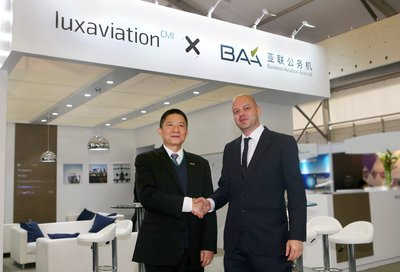 Mr. Zhu Yimin, President of CMIG Aviation and Mr. Tom Künsch, Managing Director of Luxaviation Asia