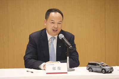 Yu Jun, General Manager of GAC Motor, speaking at a press conference about the importance of the new industrial park for boosting GAC Motor's EV business