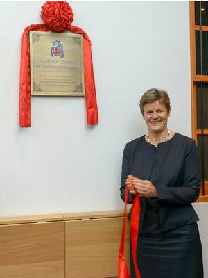 Her Majesty's Ambassador to China, Dame Barbara Woodward DCMG OBE, unveils a plaque to commemorate the official opening