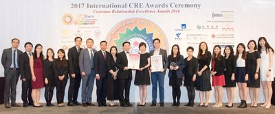 Hang Lung Properties' Head of Human Resources, Ms. Janet Poon (10th from the right), receives the awards at the presentation ceremony of the International Customer Relationship Excellence Awards 2016 with her team members.