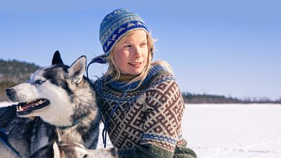 Tinja Myllykangas who lives with dozens of dogs in the wilderness of Lapland