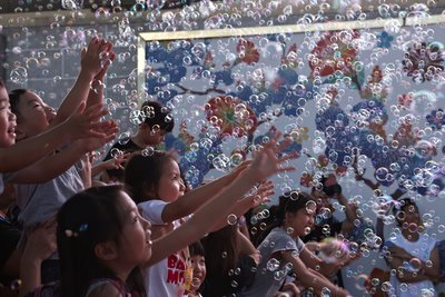 "Kids are trying to ""catch"" the bubbles."