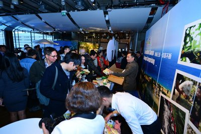 Stockholm-based attendees visiting the exhibition area for Sanya's local specialty products