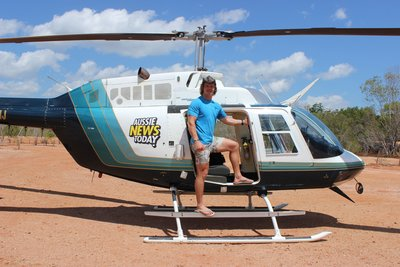 'Wallabies' rugby union star Nick Cummins (aka 'The Honey Badger') reporting from the Aussie News Today chopper to deliver the latest travel news from outback NT.