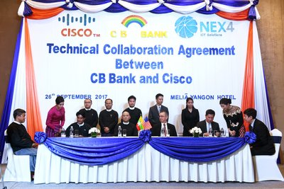 His Excellency, Mr Scot Marciel (middle right), CB Bank CEO, Mr Kyaw Lynn (middle left), with executives from CB Bank, Cisco and Nex4 during today's signing ceremony.