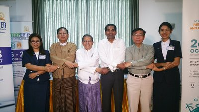 Left to right: Engr. Ei Khaing Mon of Yangon City Development Committee (YCDC); Dr. Zaw Win of Myanmar Engineering Society (MES); Engr. Khin Maung Htaey-Vice-President of MES; Mr. M. Gandhi-Managing Director of UBM Asia (ASEAN Business); Col. Thoung Win (ret)-Chairman of Renewable Energy Committee from MES; and Engr. Thwe Naing Oo- Assistant Chief Engineer of YCDC join hands for MyanmarWater 2017 and RE EE Myanmar 2017 on October 26-28, 2017 at Tatmadaw Exhibition Hall, Yangon.