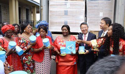 Mrs. Foh, Mrs. Koroma, and Mr. Wu Peng in the donation ceremony