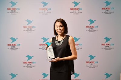 Brigette Tan, Regional Marketing Lead, Hertz Asia Pacific, collects the Best Car Rental award at Travel Weekly Asia's Readers' Choice Awards on behalf of Hertz.