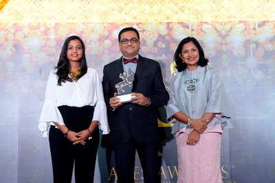 Aditya Jindal, chief finance officer, UTC Climate, Controls & Security, Southeast Asia Pacific (middle) receives the 'Top Community Care Companies in Asia' award
