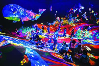 Graffiti Nature - Mountains and Valleys, an interactive ecosystem populated by the living colorful drawings which turns the space into an explosion of color.