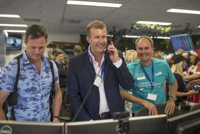 Australian television journalist and news presenter Peter Overton successfully completes a trade during ICAP's Charity Day in Sydney, Australia
