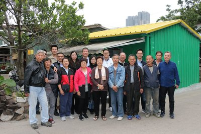 Thankful residents of Lai Chi Vun and representatives of Sands China and local construction companies gather outside one of the homes repaired with Sands China's assistance.