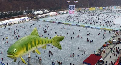 This 2017 file photo shows visitors watching sancheoneo, a type of mountain trout, during the annual Hwacheon Sancheoneo Ice Festival in Hwacheon