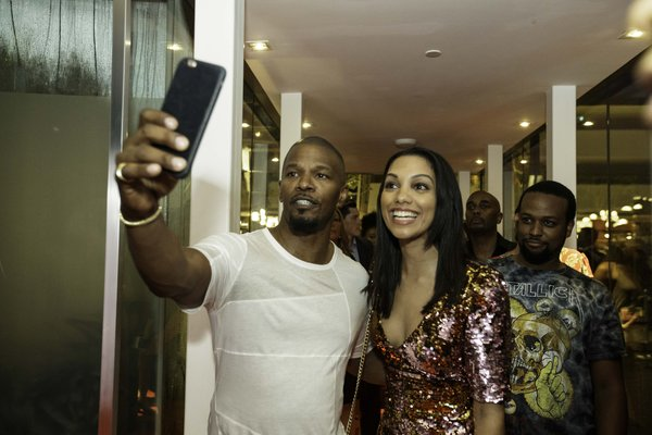 Jamie Foxx and daughter Corinne Foxx take a selfie together at Marina Bay Sands for LAVO Singapore Grand Opening