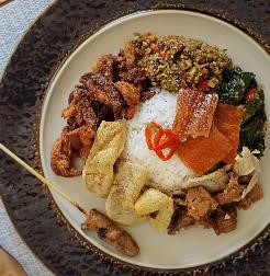 Satisfy your taste buds with Nasi Campur Bali, a local favourite