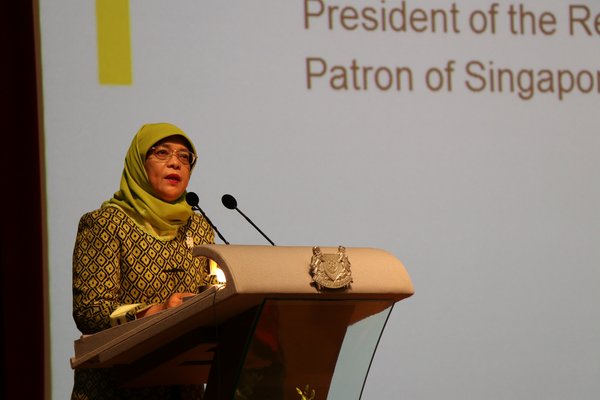 MAIDEN VISIT -- President Halimah Yacob speaks as SUSS Patron and Guest-of-Honour at the NSHD renaming ceremony.