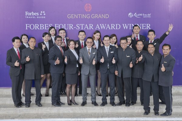 Mr. Victor Foo, Vice President of Hotel Operations (center front row in gray) with the frontliners of Genting Grand Hotel