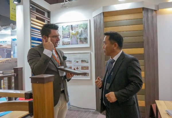 Anywood CEO Cheol-Hwan Lim (right) is consulting a buyer (left)