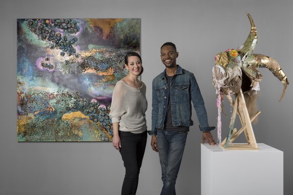 SCAD Alumni Monica Cook and Lavar Munroe with their works on the SCAD Booth, F20, at Art Central 2018. Image Courtesy of SCAD